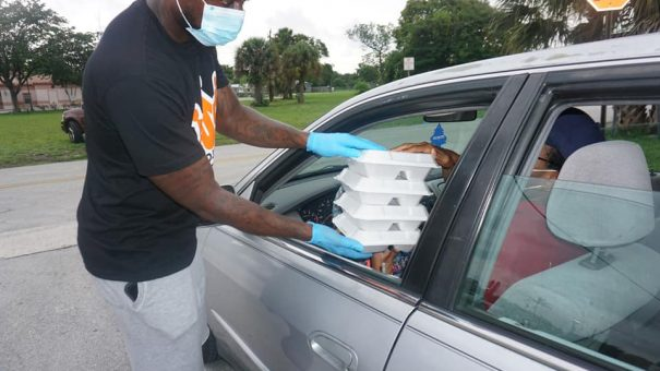 man handing out food